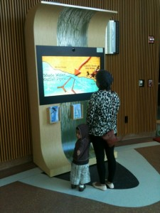 Photo showing family using MSRP kiosk at the California Science Center.