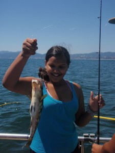 Photo showing girl that caught a fish while fishing with Marina Del Rey Anglers.